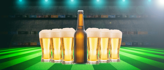 Beer glasses and a bottle on a soccer ball field background. 3d illustration
