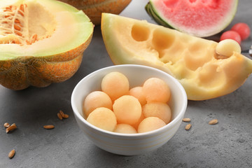 Bowl with delicious melon balls on table