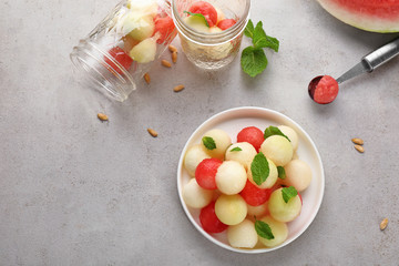 Plate of melon and watermelon balls on table