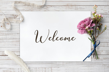 Welcome  - calligraphy on paper sheet with decorative items