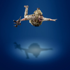 USA Army soldier with rifle (motion effect).  Shot in studio on blue background. Action concept