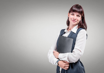 Smiling business woman on gray background. Studio shoot