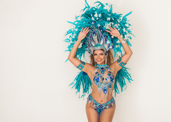 Wall Murals Carnaval Beautiful and cheerful brazilian samba dancer performing and posing