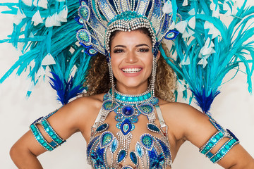 Photo Blinds Carnaval Beautiful and cheerful samba dancer portrait wearing blue traditional costume