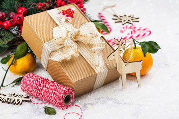 Christmas present with golden sparkles ribbon on white Christmas decorated background. Winter holidays concept. Copy space