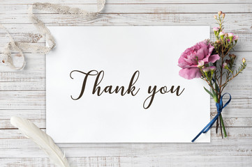 Thank you - calligraphy on white paper with decorative items
