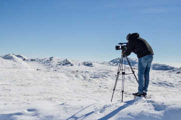 Cameraman taking video at the top of the mountain
