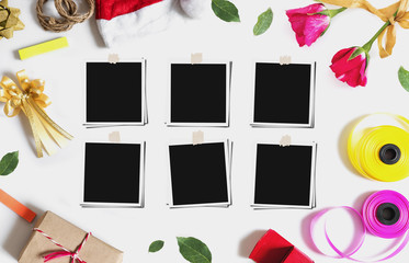 Christmas, Valentines gifts preparation with blank photo frames,  on white marble table
