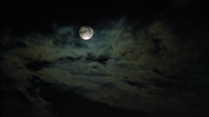 New Moon and Clouds in the Pitchblack Sky
