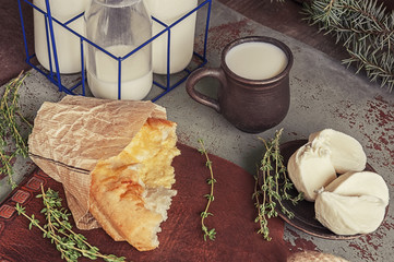 Fresh Italian Focaccia bread with mozzarella cheese and the milk in the Cup and the bottle.
