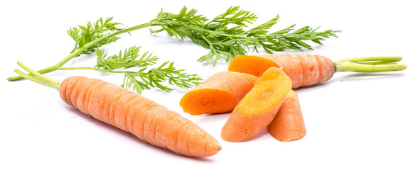 One whole fresh long orange carrot and its slices with green leaves isolated on white background