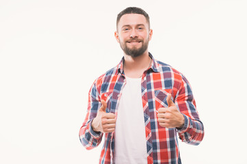 Close up portrait of a happy casual man showing thumbs up gesture over white background