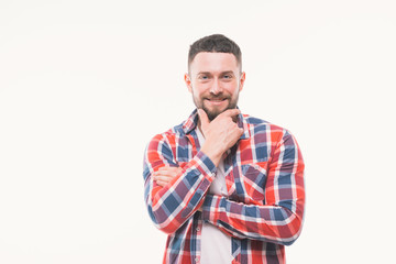 Handsome happy beard young man smiling and holding his chin, guy wearing red shirt, isolated on white background