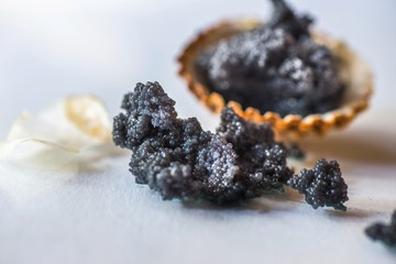 Caviar in shell and scattered on table.
