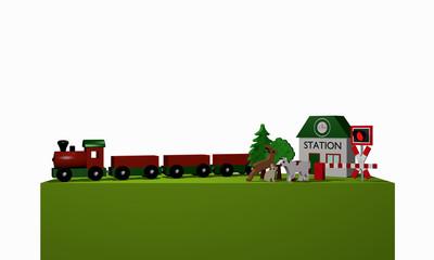 Holzspielzeug für eine Eisenbahn mit Text Bahnhof in englisch auf einem grünen Podest