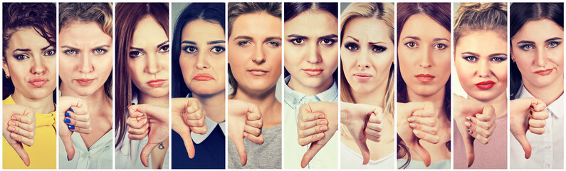 Group of multicultural women making thumbs down gesture for disagreement