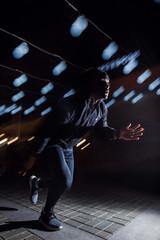 Creative stock image of a night runner. runner training at night