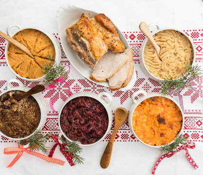 Finnish traditional Christmas table.potato, carrot, chestnut, red cabbage and liver casserole, ham and the vinaigrette Top view. Rustic style