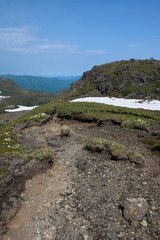 Rocky hiking trail over the mountain ranges of Daisetsuzan National Park, Hokkaido, Japan