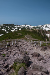 Rocky hiking trail over the mountain ranges of Daisetsuzan National Park, Hokkaido, Japan