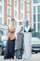 Three happy muslim girl full lenght