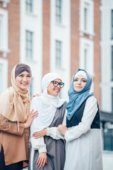 Three islamic girl walking in the city