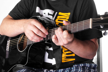 Music - black electric acoustic guitar player chord