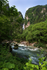 Waterfall dropping down into the Sounkyo gorge from the cliffs of Daisetsuzan National Park, Hokkaido, Japan