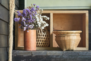 Vase, flower and room decoration with wooden material.