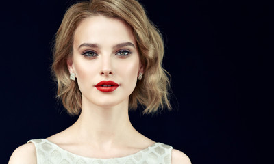 Beautiful model girl with short curly  hair and red lips . Beauty and esthetic care