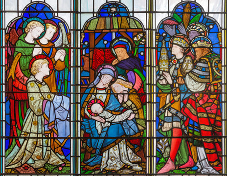 LONDON, GREAT BRITAIN - SEPTEMBER 14, 2017: The Adoration of Magi on the stained glass in the church St. Michael Cornhill by Clayton and Bell from 19. cent.