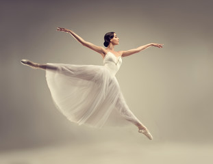 Ballerina. Young graceful woman ballet dancer, dressed in professional outfit, shoes and white...