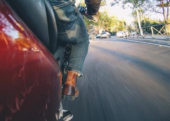 Man rides a motorcycle through Madrid, Spain.
