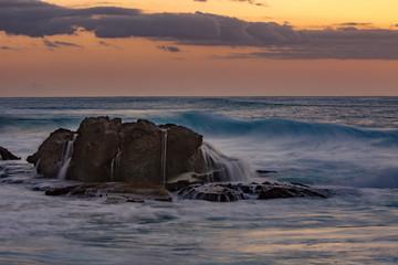 Rocks in rough ocean water, long exposure shot