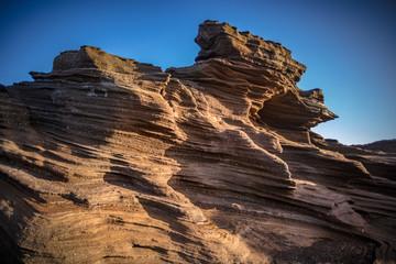 Volcanic beach shorline, wind shaped rocks, Aeolian process