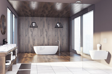 Wooden bathroom, tub, sink and toilet