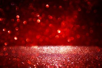 Red glitter vintage lights background. defocused.