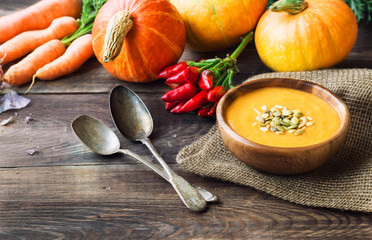 Squash soup on wooden background