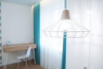 Lamp hanging from ceiling in room