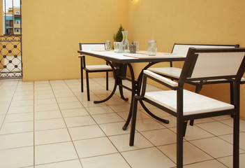 Table and chairs on roof terrace