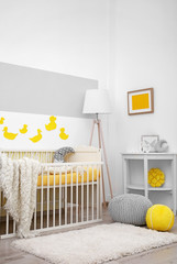 Baby bedroom with paper animals on wall