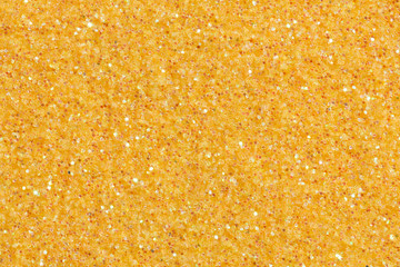 Shiny beige background with glitter.