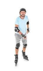 Handsome man on roller skates against white background