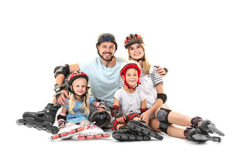 Couple and children with roller skates against white background