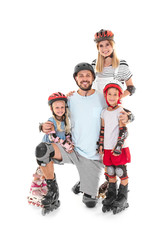 Couple with children on roller skates against white background