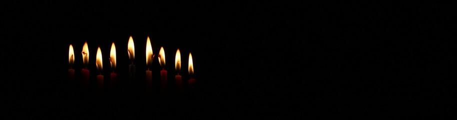 low key image of jewish holiday Hanukkah background with burning candles