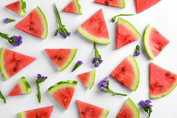 Composition with slices of ripe watermelon on white background