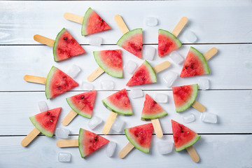 Slices of ripe watermelon on color wooden background