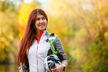 Photo of woman with backpack and bicycle helmet