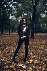 Woman holding  sparkling smoke bomb